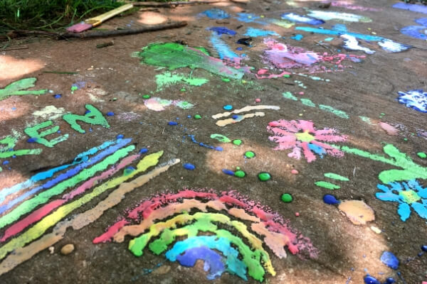 sidewalk chalk paint drawings covering a sidewalk