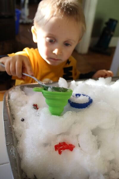 indoor snow sensory bin play