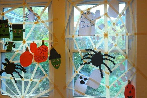 masking tap spider web in a window