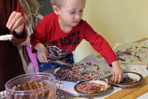 decorating a chocolate dipped pretzel