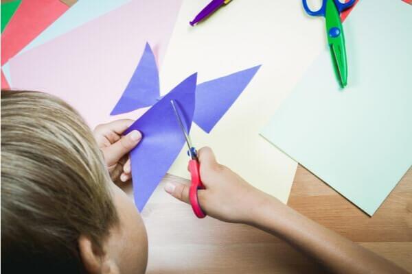 child cutting with scissors