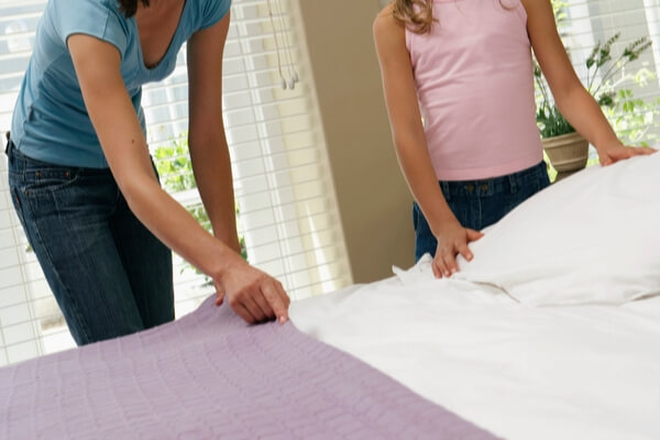 teen making bed