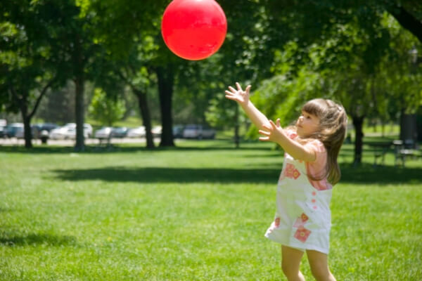 toddler throwing a ball