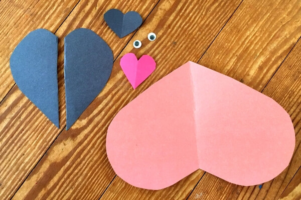 red, brown, and black paper hearts for a dog valentine craft