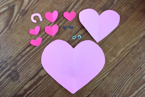 small and large pink and red paper hearts