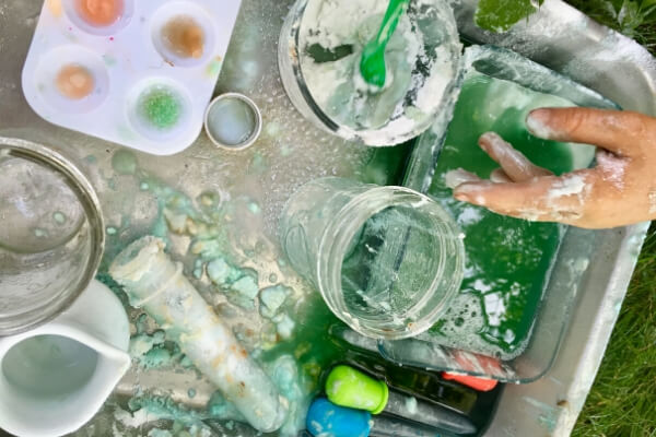 mess after playing with baking soda and vinegar in a large pan