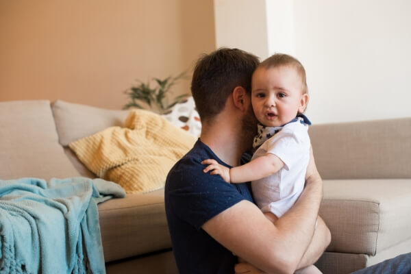father calming a crying baby
