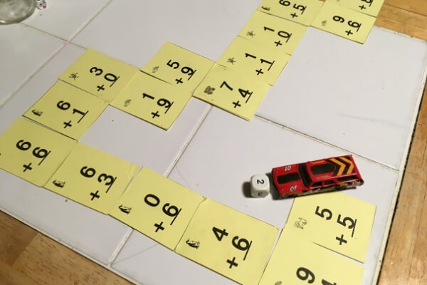race track counting game made out of flash cards