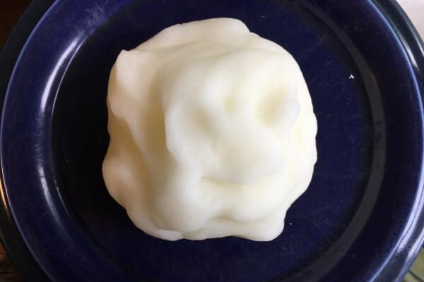 ball of homemade salt clay on a blue plate