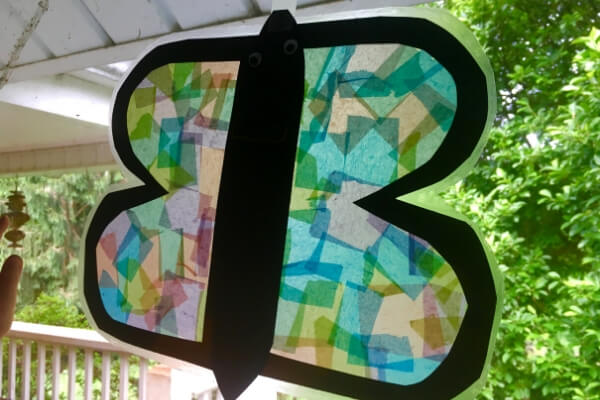 Letter B sun catcher butterfly craft hanging in a window