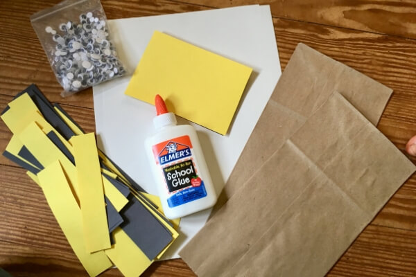 supplies need to make a bee paper bag puppet