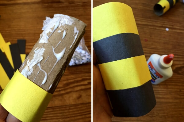 toilet paper tube being covered in yellow and black paper strips