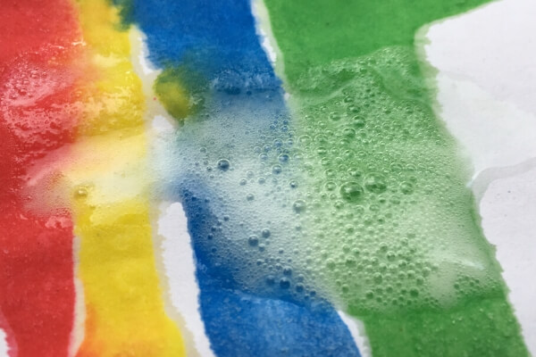 baking soda painted rainbow with vinegar dropped on to it