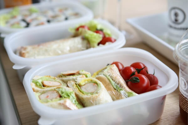 close up of 3 school lunch containers for packed school lunches