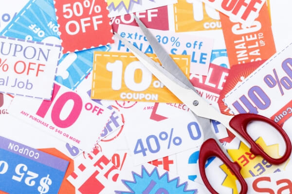 lots of coupons for various percentages off and a pair of scissors