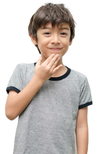 young boy saying thank you in sign language