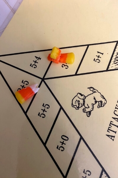 playing math games with candy corn as game pieces